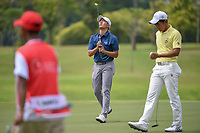 Lloyd Jefferson GO (PHI) reacts to barely missing his birdie  putt on 7 during Rd 4 of the Asia-Pacific Amateur Championship, Sentosa Golf Club, Singapore. 10/7/2018.<br /> Picture: Golffile | Ken Murray<br /> <br /> <br /> All photo usage must carry mandatory copyright credit (&copy; Golffile | Ken Murray)
