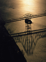 aerial photograph of a silhouette of the cantileavered Carquinez Bridge that crosses the Carquinez Straight from Crockett to Vallejo, California at sunset