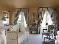 In the bedroom you are transported straight back to 18th-century Sweden via the Gustavian-style furniture and muted greys and ochres of the restrained colour scheme