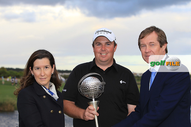 Cecilia Meireles Secretary of State for Tourism and George O'Grady Chief Executivde European Tour present the winner Shane Lowry (IRL) with the trophy at the end of Sunday's Final Round of the Portugal Masters at the Oceanico Victoria Golf Course, Vilamoura, Portugal 14th October 2012 (Photo Eoin Clarke/www.golffile.ie)
