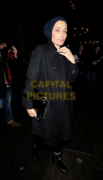 KRISTIN SCOTT THOMAS.The Gala Performance of 'Legally Blonde' at The Savoy Theatre, London, England. .January 13th, 2010 .full length beanie hat bag boots knee high hand  navy blue dress black coat.CAP/CAN.©Can Nguyen/Capital Pictures.