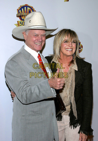 LARRY HAGMAN & LINDA GREY.Warner Bros. Television And Warner Home Video Celebrate 50 Years Of Quality TV held at the Warner Brother Studios, Burbank, California, USA,.20 January 2005..half length hat thumb up.Ref: ADM.www.capitalpictures.com.sales@capitalpictures.com.©Jacqui Wong/AdMedia/Capital Pictures .