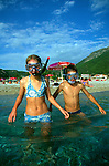 Model released two children going snorkelling in the sea, Olu Deniz, Turkey