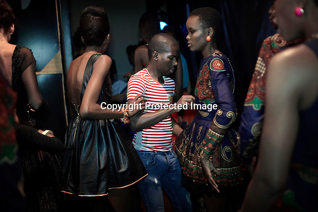 JOHANNESBURG, SOUTH AFRICA OCTOBER 27: The Mozambican designer Taibo Bacar prepares his models backstage before his show at Mercedes Benz Africa fashion week on October 27, 2012 held in Johannesburg, South Africa. African designers from around the continent showed their best fall/winter collections. Mr. Bacar won the best young designer of the year in Africa. (Photo by: Per-Anders Pettersson)