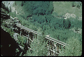 RGS Bridge 46-D on Ophir High Line. A freight led by leased D&amp;RGW #452 can be seen on grade in distance after crossing the Butterfly Trestle, Bridge 44-A, at upper left.<br /> RGS  Ophir High Line, CO  Taken by Kindig, Richard H. - 9/5/1951