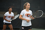 April 22, 2015; San Diego, CA, USA; Pacific Tigers tennis players Cristina Saenz de Buruaga Ruiz (front) and Regina Suarez (back) during the WCC Tennis Championships at Barnes Tennis Center.