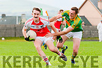 Daingean Uí Chúis Cathal Ó Bambaire tackled by South Kerry Brendan O'Sullivan during the match at Pairc an Aghasaigh, Dingle, on Sunday afternoon.