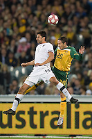MELBOURNE, AUSTRALIA - MAY 24, 2010: Mark Milligan of the Qantas Socceroos and Rory Fallon of New Zealand contest for the ball at the FIFA World Cup farewell match between Australia and New Zealand at the Melbourne Cricket Ground, 24 May, 2010 in Melbourne, Australia. Photo by Sydney Low / www.syd-low.com