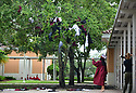 PEMBROKE PINES, FL - MAY 15: Student Kayli Trexler takes part in the last day of school tradition of dipping uniform shirts in the campus fountain and then throwing them into a tree at Pembroke Pines Charter High School on May 15, 2020 in Pembroke Pines, Florida. Because of social distancing mandates instituted by the state to curtail the spread of COVID-19, the 2020 graduates received their diplomas in a near-empty auditorium with no friends, family or relatives allowed to attend. A video of each student walking the stage to receive their diploma will be streamed on the school's scheduled graduation date of May 29.  ( Photo by Johnny Louis / jlnphotography.com )