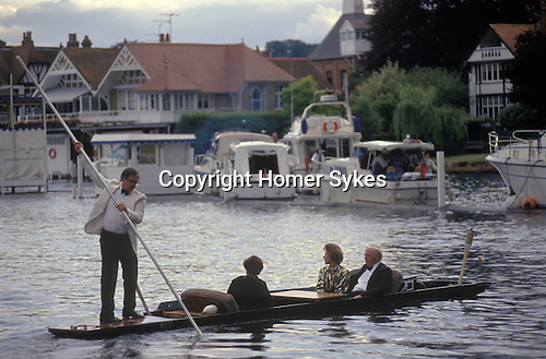 Henely on Thames, punting across the river during the Henley Music Festival  week. Oxfordshire UK.
