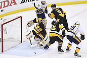 8th June 2017, Pittsburgh, PA, USA; Pittsburgh Penguins goalie Matt Murray (30) makes a save on Nashville Predators left wing James Neal (18) in front as Pittsburgh Penguins defenseman Ron Hainsey (65) defends during the first period in Game Five of the 2017 NHL Stanley Cup Final between the Nashville Predators and the Pittsburgh Penguins on June 8, 2017, at PPG Paints Arena