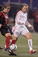 The MetroStars' Jeff Parke clears the ball as Real Salt Lake's Clint Mathis runs on to it. The weather was the story with 50 mph winds, rain, and a brief power outage as the MetroStars played Real Salt Lake to a scoreless tie during opening day action of season 10 of the MLS at Giant's Stadium, East Rutherford, on Saturday April 2, 2005.