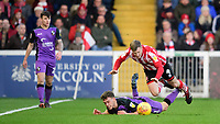 Port Vale's Luke Hannant is fouled by Lincoln City's Michael O'Connor<br /> <br /> Photographer Chris Vaughan/CameraSport<br /> <br /> The EFL Sky Bet League Two - Lincoln City v Port Vale - Tuesday 1st January 2019 - Sincil Bank - Lincoln<br /> <br /> World Copyright © 2019 CameraSport. All rights reserved. 43 Linden Ave. Countesthorpe. Leicester. England. LE8 5PG - Tel: +44 (0) 116 277 4147 - admin@camerasport.com - www.camerasport.com