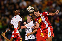 Western New York Flash forward Abby Wambach (20) goes up for a header with Sky Blue FC forward Danesha Adams (9) and defender CoCo Goodson (2). The Western New York Flash defeated Sky Blue FC 2-0 during a National Women's Soccer League (NWSL) semifinal match at Sahlen's Stadium in Rochester, NY, on August 24, 2013.