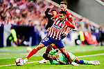 Junior Firpo of Real Betis (L) fights for the ball with Angel Correa of Atletico de Madrid (R) during the La Liga 2018-19 match between Atletico de Madrid and Real Betis at Wanda Metropolitano Stadium on October 07 2018 in Madrid, Spain. Photo by Diego Souto / Power Sport Images