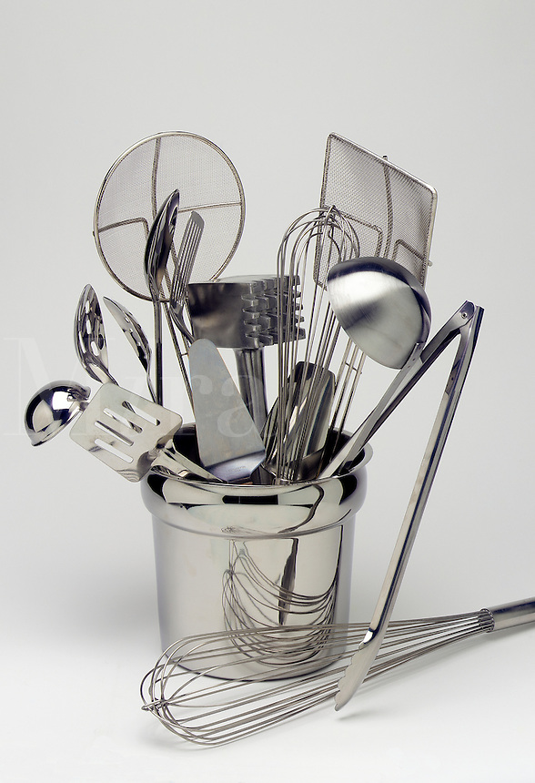stainless steel kitchen utensils aranged in a stainless steel container