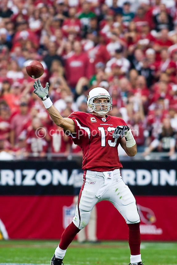 Jan 18, 2009; Glendale, AZ, USA; Arizona Cardinals quarterback Kurt Warner (13) throws a pass in the second quarter of the NFC Championship Game against the Philadelphia Eagles at University of Phoenix Stadium.  The Cardinals won the game 32-25 to advance to Super Bowl XLIII.