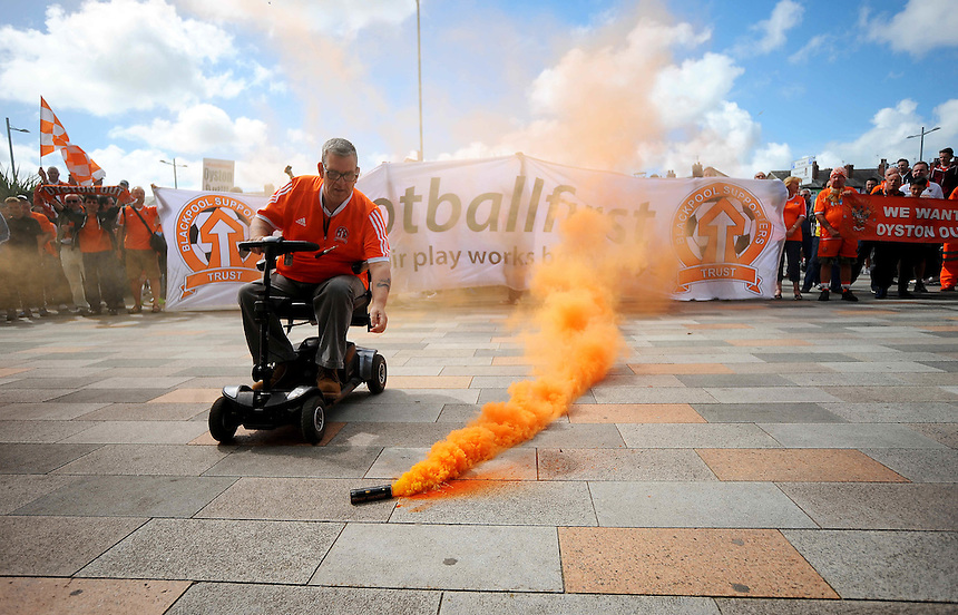 A Blackpool fan gathers a flare as fans stage a protest against the club's owners before todays match<br /> <br /> Photographer Kevin Barnes/CameraSport<br /> <br /> Football - The Football League Sky Bet League One - Blackpool v Rochdale - Saturday 15th August 2015 - Bloomfield Road - Blackpool<br /> <br /> &copy; CameraSport - 43 Linden Ave. Countesthorpe. Leicester. England. LE8 5PG - Tel: +44 (0) 116 277 4147 - admin@camerasport.com - www.camerasport.com