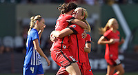 Portland, Oregon - Sunday September 4, 2016: Portland Thorns FC midfielder Lindsey Horan (7) and Portland Thorns FC forward Christine Sinclair (12) hug after Sinclair scored a goal during a regular season National Women's Soccer League (NWSL) match at Providence Park.