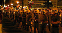 Aug 27, 2004 - Athens, Greece - Greek riot police line up in front of Syntagma square in Athens Friday as protestors move past them. The group, shouting anti-war slogans, was protesting the visit of U.S. Secretary of State Colin Powell..(Credit Image: © Alan Greth)