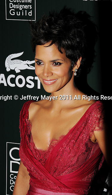 BEVERLY HILLS, CA - FEBRUARY 22: Halle Berry arrives at the 13th Annual Costume Designers Guild Awards with presenting sponsor Lacoste held at The Beverly Hilton Hotel on February 22, 2011 in Beverly Hills, California.