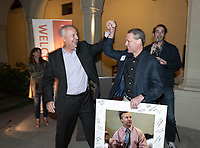 Coach Brian Newhall '83 and Ethan Caldwell '90<br /> Now in his 30th year as Oxy's head men's basketball coach, Brian Newhall received a much deserved celebration with a surprise halftime ceremony and post game reception in the Booth Hall courtyard with more than 70 former and current players from all different generations and decades in attendance, on Saturday, Jan. 26, 2019.<br /> Newhall is the winningest coach in Oxy history and has a 100 percent graduation rate in his 30 years at the helm of the program. His resume boasts multiple SCIAC Championships and NCAA Playoff appearances, along with a run to the NCAA Division III Elite Eight in 2003 and the only perfect 14-0 season in SCIAC history. Newhall has not only coached at Oxy, but was a SCIAC Champion and SCIAC Player of the Year during his playing career at Oxy in the early 80s.<br /> (Photo by Marc Campos, Occidental College Photographer)