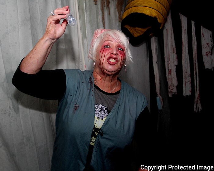 Nurse Valerie greets guest at the Ghost Ship Harbor Haunted House tour aboard Quincy's USS Salem.  (Photo by Gary Wilcox)