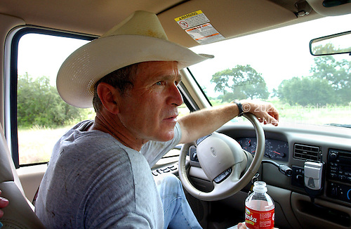 United States President George W. Bush drives his pickup truck at his ranch in Crawford, Texas, Friday, August 9, 2002. <br /> Mandatory Credit: Eric Draper - White House via CNP