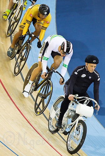 18 FEB 2012 - LONDON, GBR - Peter Deary leads the competitors on his derny during the first round of the Men's Keirin at the UCI Track Cycling World Cup, and London Prepares test event for the 2012 Olympic Games, in the Olympic Park Velodrome in Stratford, London, Great Britain (PHOTO (C) 2012 NIGEL FARROW)