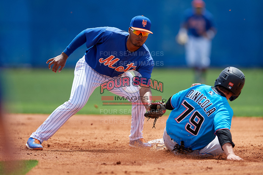 New York Mets second baseman Yoel Romero (24) looks to tag Harrison Dinicola (79) sliding in during a Minor League Extended Spring Training game against the Miami Marlins on April 12, 2019 at First Data Field Complex in St. Lucie, Florida.  (Mike Janes/Four Seam Images)