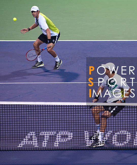 SHANGHAI, CHINA - OCTOBER 14:  Bob and Mike Brian in action during their doubles match against Simon Aspelin of Sweden and Paul Hanley of Australia during day four of the 2010 Shanghai Rolex Masters at the Shanghai Qi Zhong Tennis Center on October 14, 2010 in Shanghai, China.  (Photo by Victor Fraile/The Power of Sport Images) *** Local Caption *** Bob Brian; Mike Brian