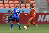 Houston, TX - Saturday May 27, 2017: Andressa (17) of the Houston Dash attempts to dribble the ball around Jess Fishlock during a regular season National Women's Soccer League (NWSL) match between the Houston Dash and the Seattle Reign FC at BBVA Compass Stadium.