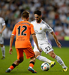 Isco Alarcon vies with Joao Pereira during the Spanish league football match Real Madrid CF vs Valencia CF at the Santiago Bernabeu stadium in Madrid on May 4, 2014. PHOTOCALL3000/