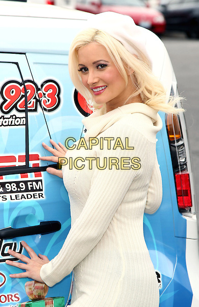 HOLLY MADISON.hosts KOMP 92.3 toy drive for Toys For Tots at Findley Kia, Las Vegas, Nevada, USA, 4th December 2010..half length white cream polo neck jumper sweater dress black leggings hat beret.CAP/ADM/MJT.© MJT/AdMedia/Capital Pictures.