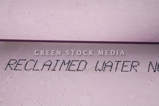 """Reclaimed Water"" text on purple PVC water pipe. Purple is the color code for reclaimed water. The cities of Palo Alto and Mountain View are jointly constructing a reclaimed water pipeline to carry recycled water from the Palo Alto Regional Water Quality Control Plant to customers along East Bayshore Parkway and Mountain View's North Bayshore area."