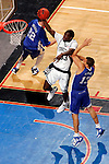 Connecticut forward Denham Brown (33) drives past Kentucky forward Bobby Perry (13).  Connecticut defeated Kentucky 87-83 in the second round of the NCAA Tournament  at the Wachovia Center in Philadelphia, Pennsylvania on March 19, 2006.