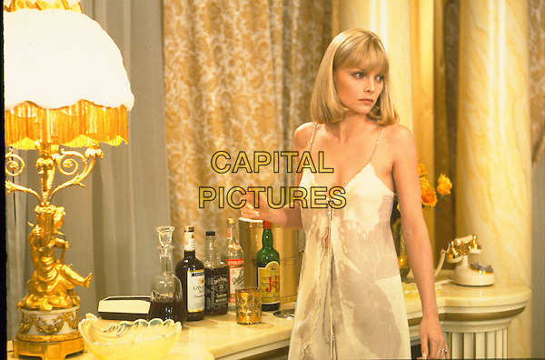 MICHELLE PFEIFFER  .in Scarface.Filmstill - Editorial Use Only.Ref: FB.sales@capitalpictures.com.www.capitalpictures.com.Supplied by Capital Pictures.