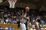 24 February 2012: Miami's Shenise Johnson (42) shoots over Duke's Elizabeth Williams (1). The Duke University Blue Devils defeated the University of Miami Hurricanes at Cameron Indoor Stadium in Durham, North Carolina in an NCAA Division I Women's basketball game.
