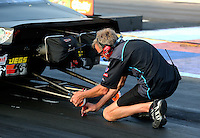 Apr 25, 2014; Baytown, TX, USA; A crew member for NHRA pro stock driver Jonathan Gray during qualifying for the Spring Nationals at Royal Purple Raceway. Mandatory Credit: Mark J. Rebilas-