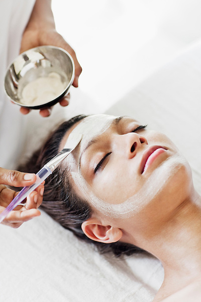 Woman Receiving Facial at Six Senses Spa, Heritance Kandalama, Dambulla, Sri Lanka. The Thai Facial at Six Senses Spa is five-step treatment that involves: cleansing the face with a yogurt-honey mixture; exfoliating the face with raw brown sugar; moisturizing the face with sweet almond oil; applying a facial mask made of blended Thai herbs; and finishing off with cucumber to tone and balance the complexion. November14,2008. Dambulla, Sri Lanka.