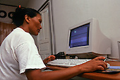 Altamira, Amazon, Brazil. Miriam on the net at Amazoncoop internet cafe; owned by six Indian tribes.