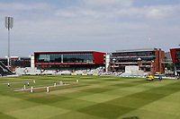 The players look on as the air ambulance lands on the outfield to attend a medical emergency during Lancashire CCC vs Essex CCC, Specsavers County Championship Division 1 Cricket at Emirates Old Trafford on 11th June 2018