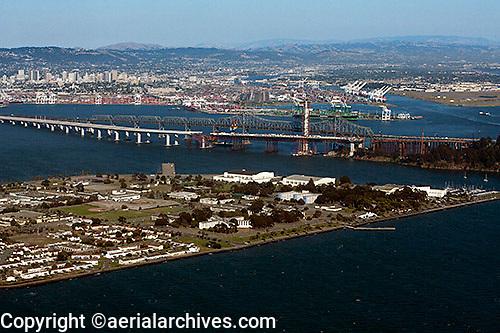 aerial photograph Treasure Island San Francisco toward Bay Bridge Construction Port of Oakland and downtown Oakland