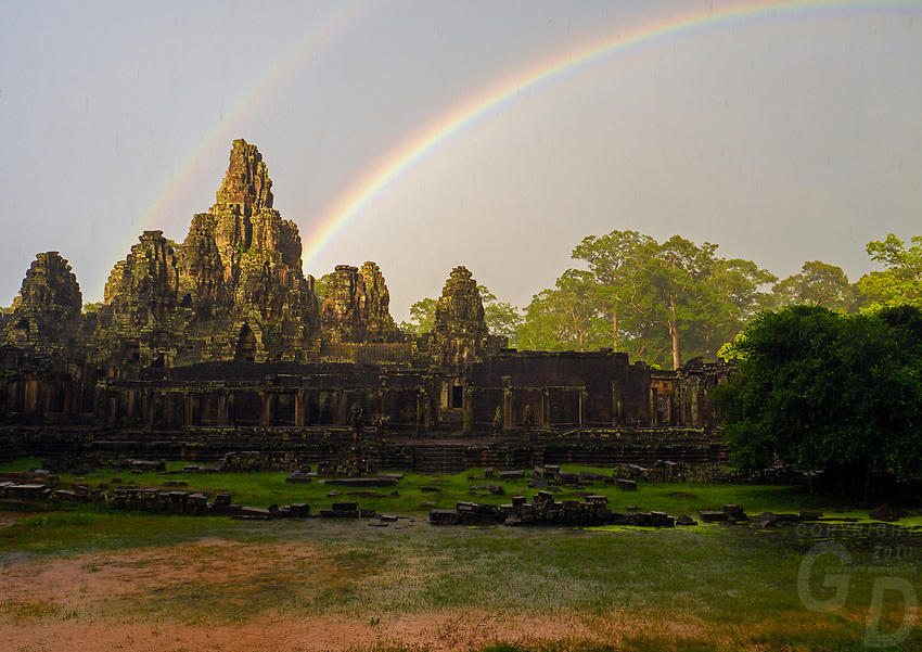 A rare Rainbow over the Bayon Temple in the Angkor Wat area; a World Heritage Site in Cambodia and the ever changing Weather during the Monsoon Season.