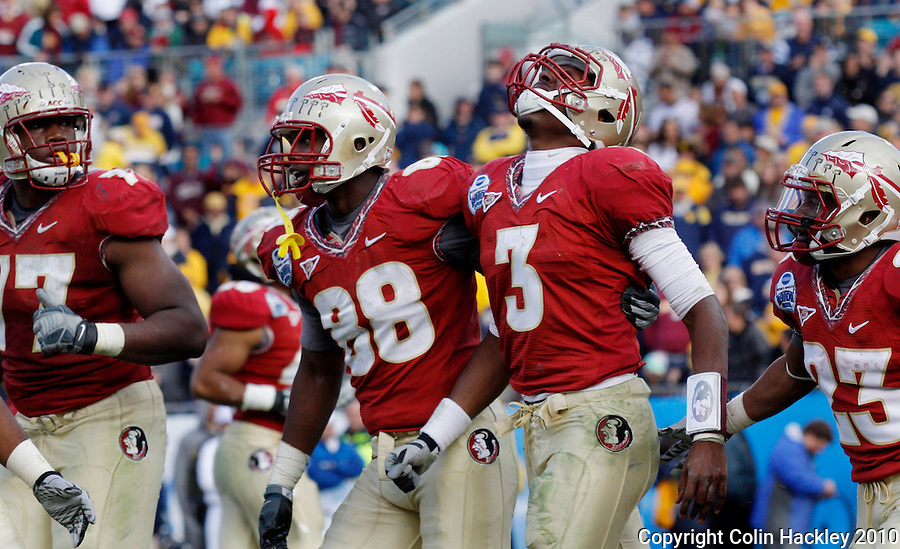 JACKSONVILLE, FL 1/1/10-FSU-WV FB CH63-Florida State's EJ Manuel walks off the field in pain after scoring a touchdown against West Virginia's during second half Gator Bowl action Friday in Jacksonville, Fla. The Seminoles beat the Mountaineers 33-21..COLIN HACKLEY PHOTO