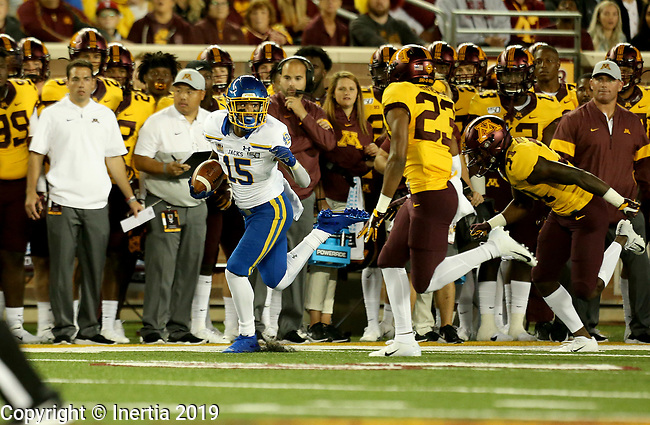 MINNEAPOLIS, MN - AUGUST 29: Cade Johnson #15 from South Dakota State University scampers down the sideline past the defense from the University of Minnesota during their game Thursday night at TCF Bank Stadium in Minneapolis, MN. (Photo by Dave Eggen/Inertia)