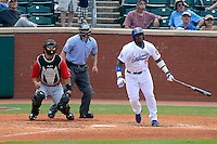 Chattanooga Lookouts outfielder Yasiel Puig #66 at bat in front of catcher Miguel Gonzalez #33 and umpire Derek Mollica during a game against the Birmingham Barons on April 17, 2013 at AT&T Field in Chattanooga, Tennessee.  Chattanooga defeated Birmingham 5-4.  (Mike Janes/Four Seam Images)