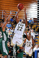 11 November 2011:  FIU's Jerica Coley (22) shoots a jump shot over Jacksonville's Tracie Sneed (22) in the second half as the FIU Golden Panthers defeated the Jacksonville University Dolphins, 63-37, at the U.S. Century Bank Arena in Miami, Florida.