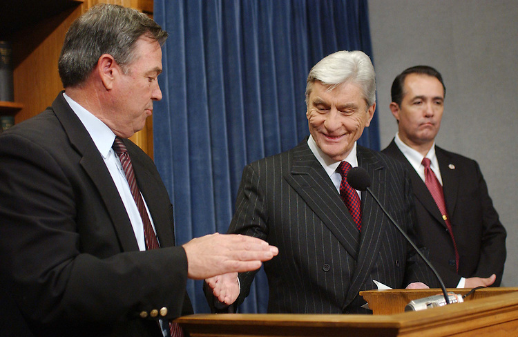 12/06/04.INTELLIGENCE REFORM BILL--House Armed Services Chairman Duncan Hunter, R-Calif., and Senate Armed Services Chairman John W. Warner, R-va., during a news conference announcing their satisfaction with new language in the intelligence reform bill. At right is Trent Franks, R-Ariz. Hunter is one of the last holdouts on the intelligence bill (S 2845). The new language he endorsed would assure that a director of national intelligence would not interfere with the chain of command in the military -- an issue that has stalled the legislation for more than a month. The House will debate the bill tomorrow, the Senate on Wednesday..CONGRESSIONAL QUARTERLY PHOTO BY SCOTT J. FERRELL