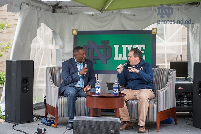 Oct. 16, 2015; Kevin Brennan interviews Heisman Trophy winner Tim Brown during the Alumni Association 'Football Fridays at the Eck' event. (Photo by Matt Cashore/University of Notre Dame)